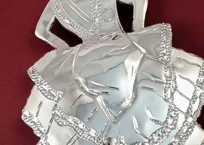 Muñeca de plata hecha a mano